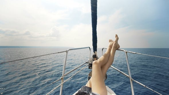 Thumbnail for The Legs of a Girl on a Yacht, Luxury Summer Lifestyle Happy Adventure Travel Vacation