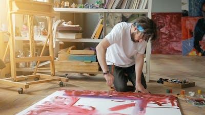 Painter Works on Floor