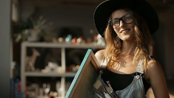 Thumbnail for Female Artist Shows Paintbrushes