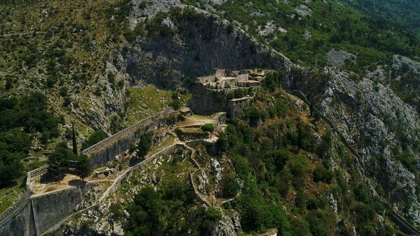 Thumbnail for Aerial View at Historical Wall of Saint John Fortress in Kotor City on the Kotor Bay in Montenegro