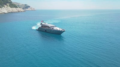 Amazing View To Yacht Sailing in Sea. Stock. Sunset View of the Yacht. Luxury Vacation on a Yacht