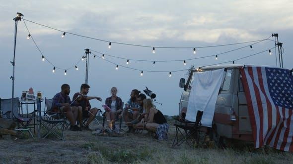Thumbnail for Tourists Frying Marshmallows at Camping Bonfire