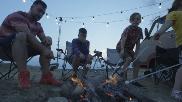 Thumbnail for Laughing Family Frying Marshmellow on Bonfire