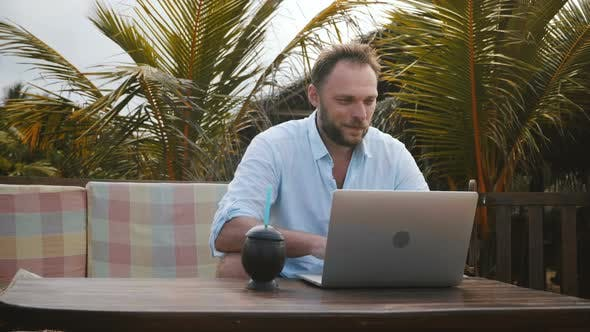 Thumbnail for Medium Shot of Happy Successful Smiling Middle Aged Businessman Using Laptop To Work Online on