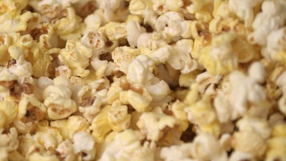 Thumbnail for Fresh Hot Popcorn Mixing Popcorn Machine. Popcorn Background