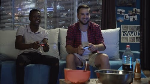 Diverse People Entertaining with Videogame
