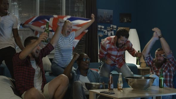 Diverse Fans Clinking with Beer Watching Game