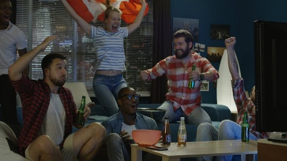 Excited Patriotic Fans with Beer Watching Game