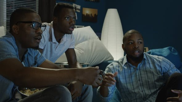 Thumbnail for Black Men Watching Sports and Making Bets