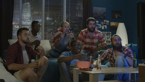 Friends Watching Sport Game at Home
