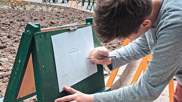 Thumbnail for Young Man Artist Drawing on Large Paper