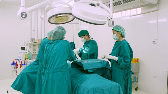 Team of Surgeons in Operating Theater.