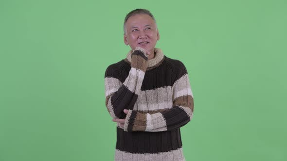 Thumbnail for Happy Mature Japanese Man Thinking Ready for Winter