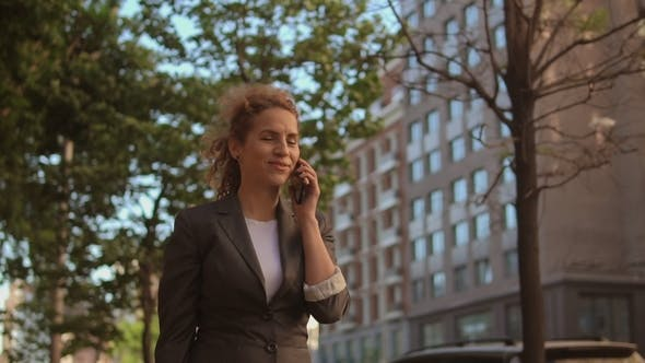 Thumbnail for Busy Woman in Grey Suit Talking on the Phone