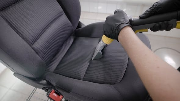 Thumbnail for Person Cleaning Folds of Car Seat