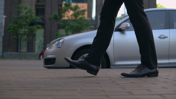 Thumbnail for Male Legs in Black Shoes