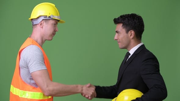 Thumbnail for Multi-ethnic Young Businessman and Young Construction Worker Working Together Against Green
