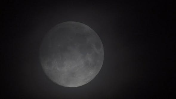 Thumbnail for Full Moon  As It Eventually Becomes Obscured By Clouds