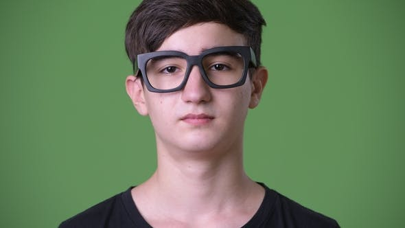 Thumbnail for Young Handsome Iranian Teenage Boy Against Green Background