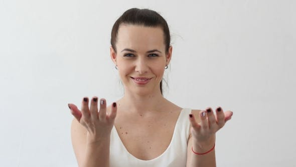 Thumbnail for Inviting Gesture By Beautiful Young Woman, Portrait