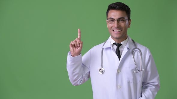 Thumbnail for Young Handsome Hispanic Man Doctor Against Green Background