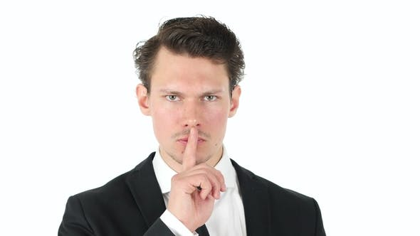 Silence, Shut Your Mouth, Finger on Lips of Businessman