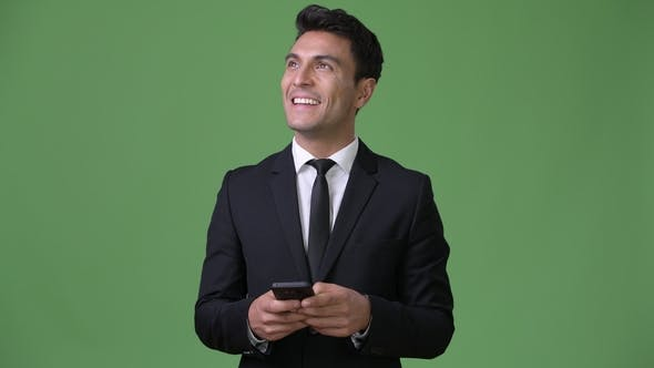 Thumbnail for Young Handsome Hispanic Businessman Against Green Background