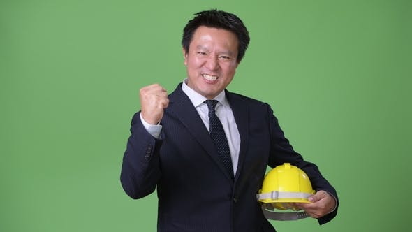 Thumbnail for Mature Japanese Businessman Against Green Background