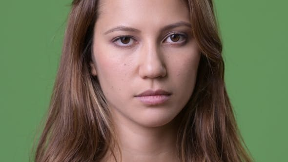 Thumbnail for Young Beautiful Multi-ethnic Woman Against Green Background