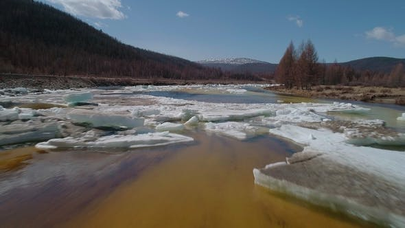 Thumbnail for Flying Over a Melting River Ice Cover in Spring
