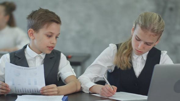 Thumbnail for Business Children Working with Documents and with Laptop