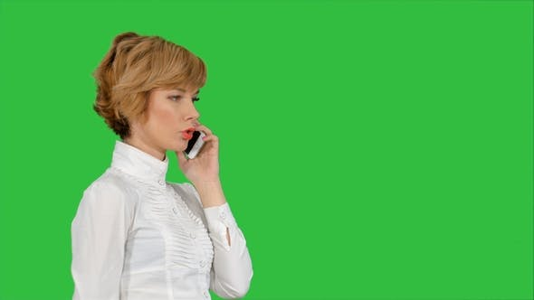 Thumbnail for Happy Businesswoman Speaking at the Phone on a Green Screen, Chroma Key