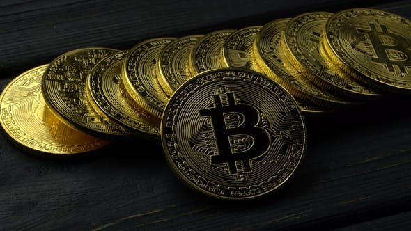 Thumbnail for E-business Currency Bitcoin Gold Coins on Grey Table.