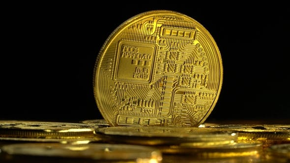 Thumbnail for Gold Coins Bitcoin Cryptocurrency Spinning on a Black Background.
