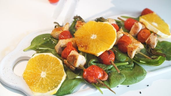 Thumbnail for Chicken Kebabs Served with Tomato Cherry and Greenery