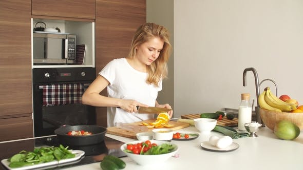 Thumbnail for Portrait of Happy Female Wife in White T-shirt Cooking Dinner