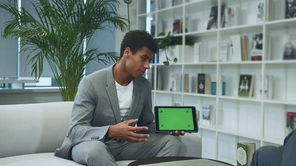 Thumbnail for Black Formal Man Making Presentation with Tablet with Green Chromakey Screen. Young African-American