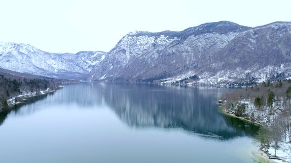 Thumbnail for Aerial Flying Over the Bohinj Lake Near Mountains