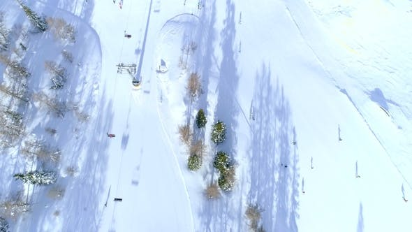 Thumbnail for Aerial Bird's Eye Several Skiers Ski Resort Vogel