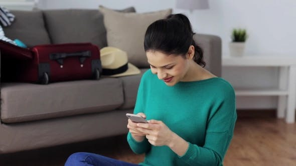 Thumbnail for Woman with Smartphone at Home Going To Travel