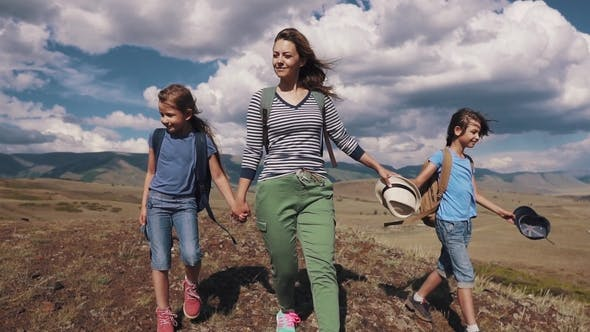 Thumbnail for Family of Tourists on a Journey Mother with Two Daughters in the Campaign Children with Backpacks