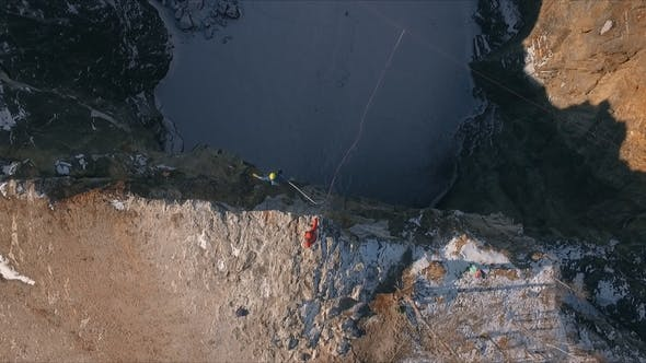 Thumbnail for Aerial View of a Man Jumping Off a Cliff. Rope Jumping.
