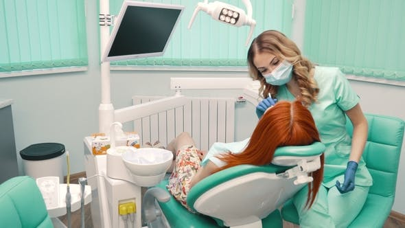 Thumbnail for Young Woman at Reception with Dentist