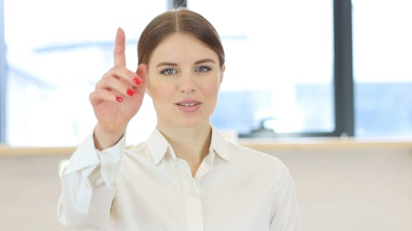 Cover Image for Pointing Toward Camera, Woman in Office