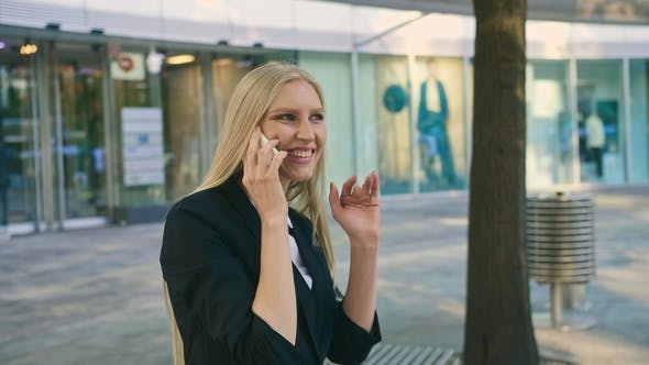 Thumbnail for Cheerful Executive Woman Waving with Hand. Adult Blond Businesswoman in Suit Sitting on Bench