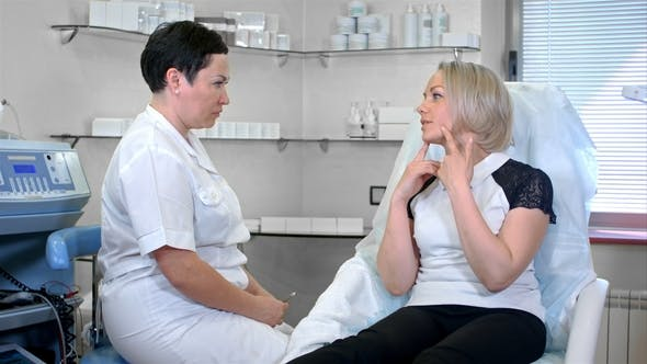 Thumbnail for Cosmetologist Talking with Woman Client in Her Office