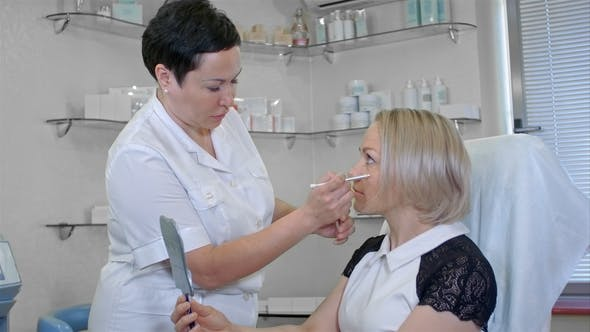 Thumbnail for Cosmetologist Doing Draw Correction Lines on Woman Face