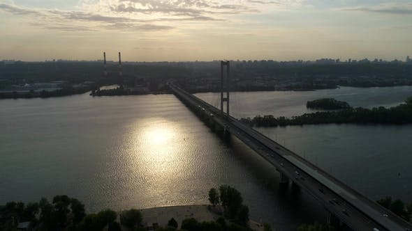 Thumbnail for Aerial View of a City Traffic on the Bridge in the Evening.