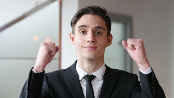 Thumbnail for Young Businessman Celebrating Success
