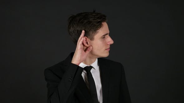 Thumbnail for Listening Carefully Businessman, Dark Black Background
